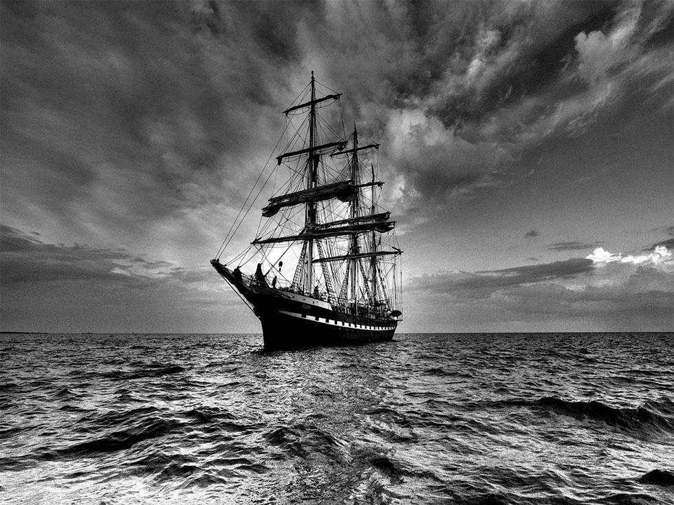 black white photography sailboat