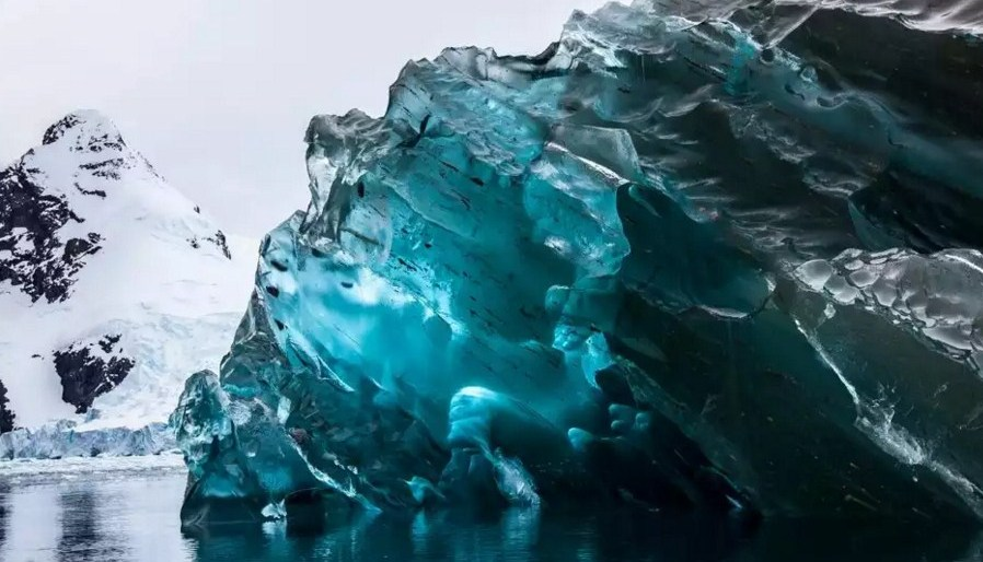 antarctica blue iceberg photography by alex cornell