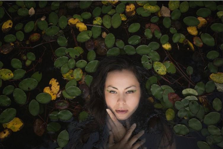 travel photography woman swim by dave brosha