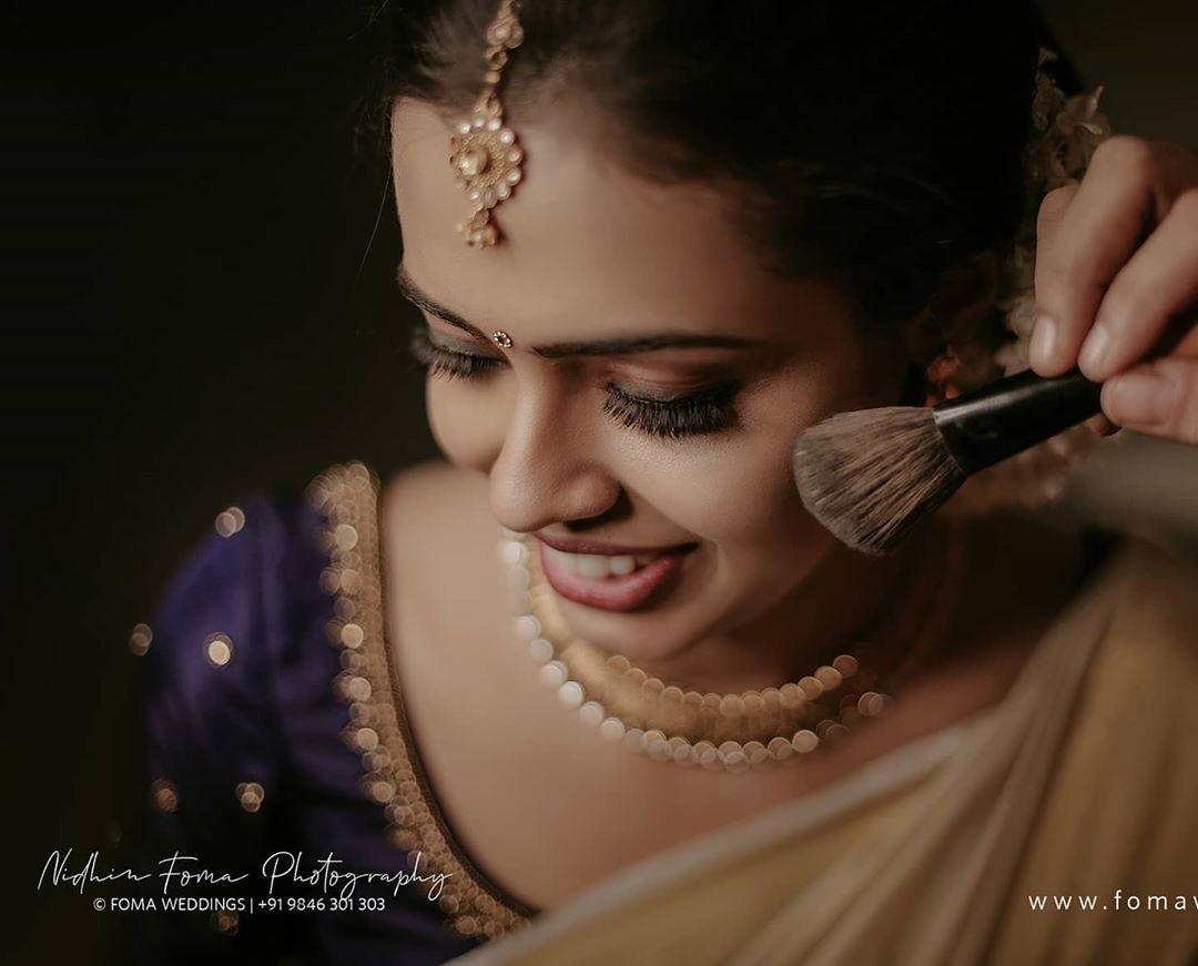 wedding photography gettng ready by nidhin foma