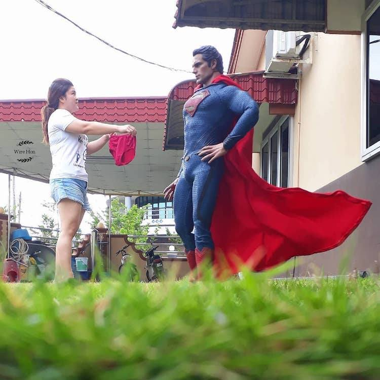 forced persepective photography superman by wire hon