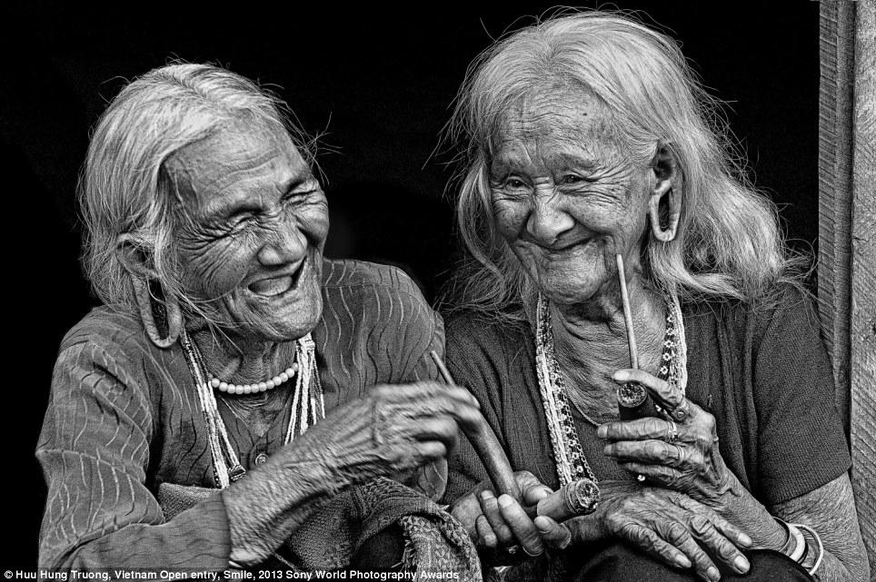 black white photography two vietnamese friends world smile day by michaelkonik