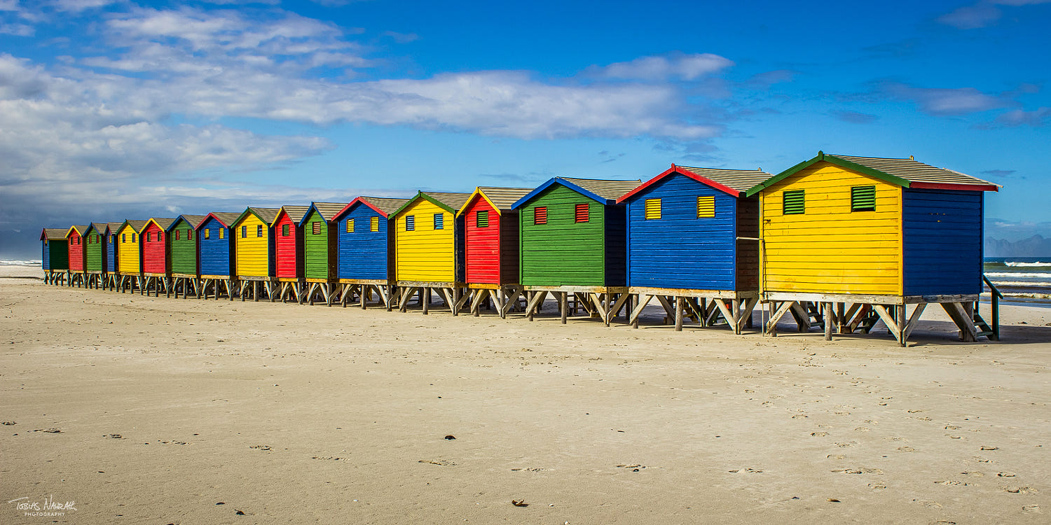 photography huts beach by tobias nawrath