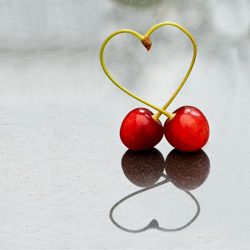 reflection photography cherries