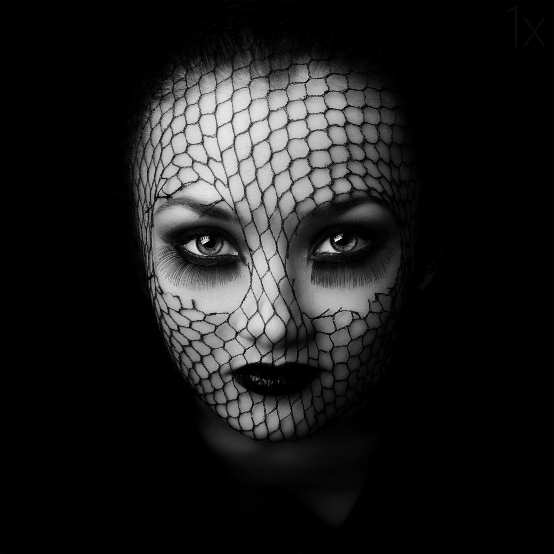black white photography net face by oren hayman
